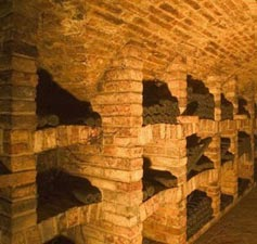 Brick bins in barrel vaulted wine cellar